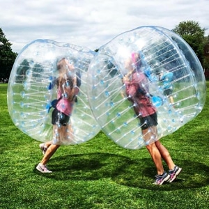 Two girls running each other in Bubble Balls