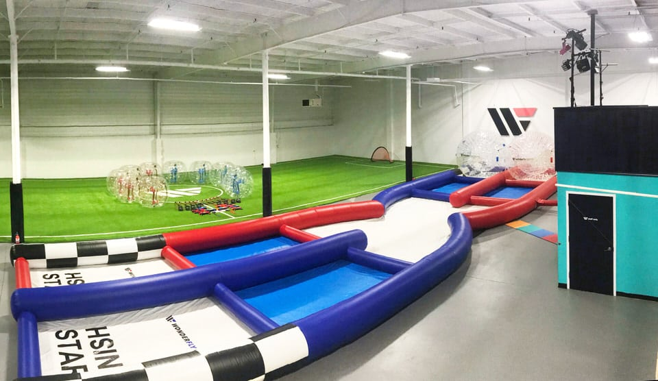 Wonderfly Arena image with hamster tracker, hamster balls and turf field